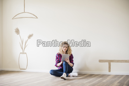 young woman in new home sitting