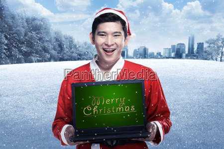 santa, claus, holding, laptop, with, merry - 22752913