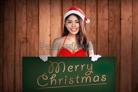 santa, woman, holding, merry, christmas, board - 22752957