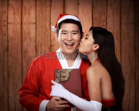 santa woman give kiss to her