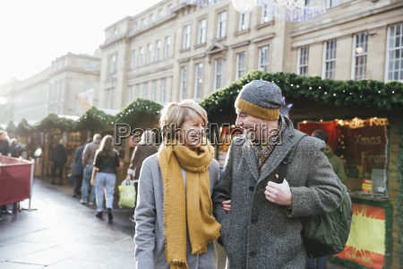 mature couple in christmas market