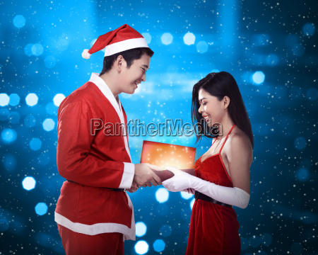 man, in, santa, claus, costume, give - 22753129