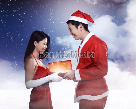 man, in, santa, claus, costume, give - 22753147