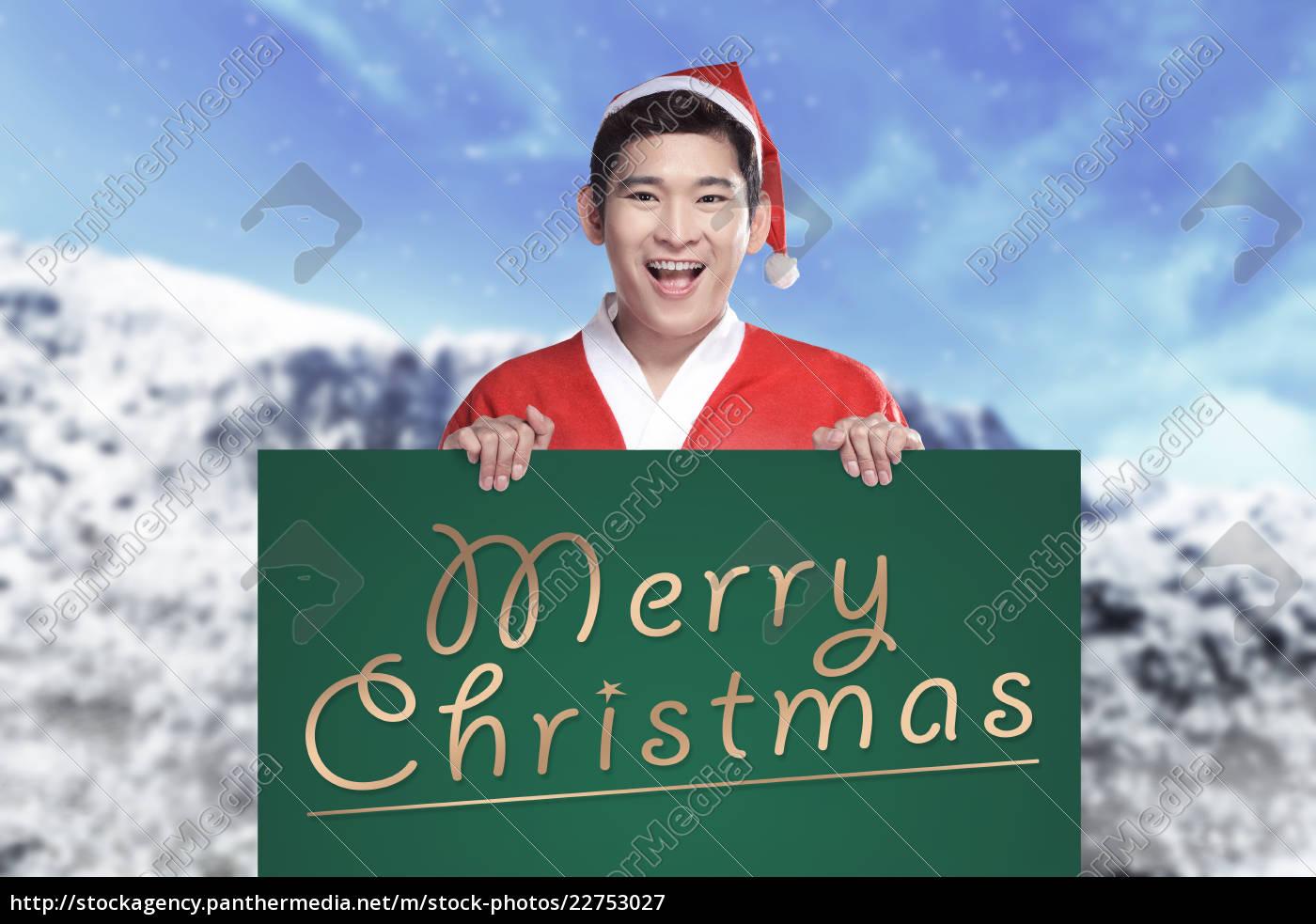 man, wearing, santa, claus, costume, holding - 22753027