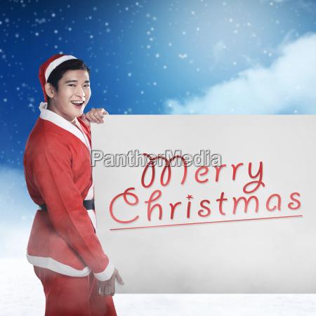 man, wearing, santa, claus, costume, holding - 22753133