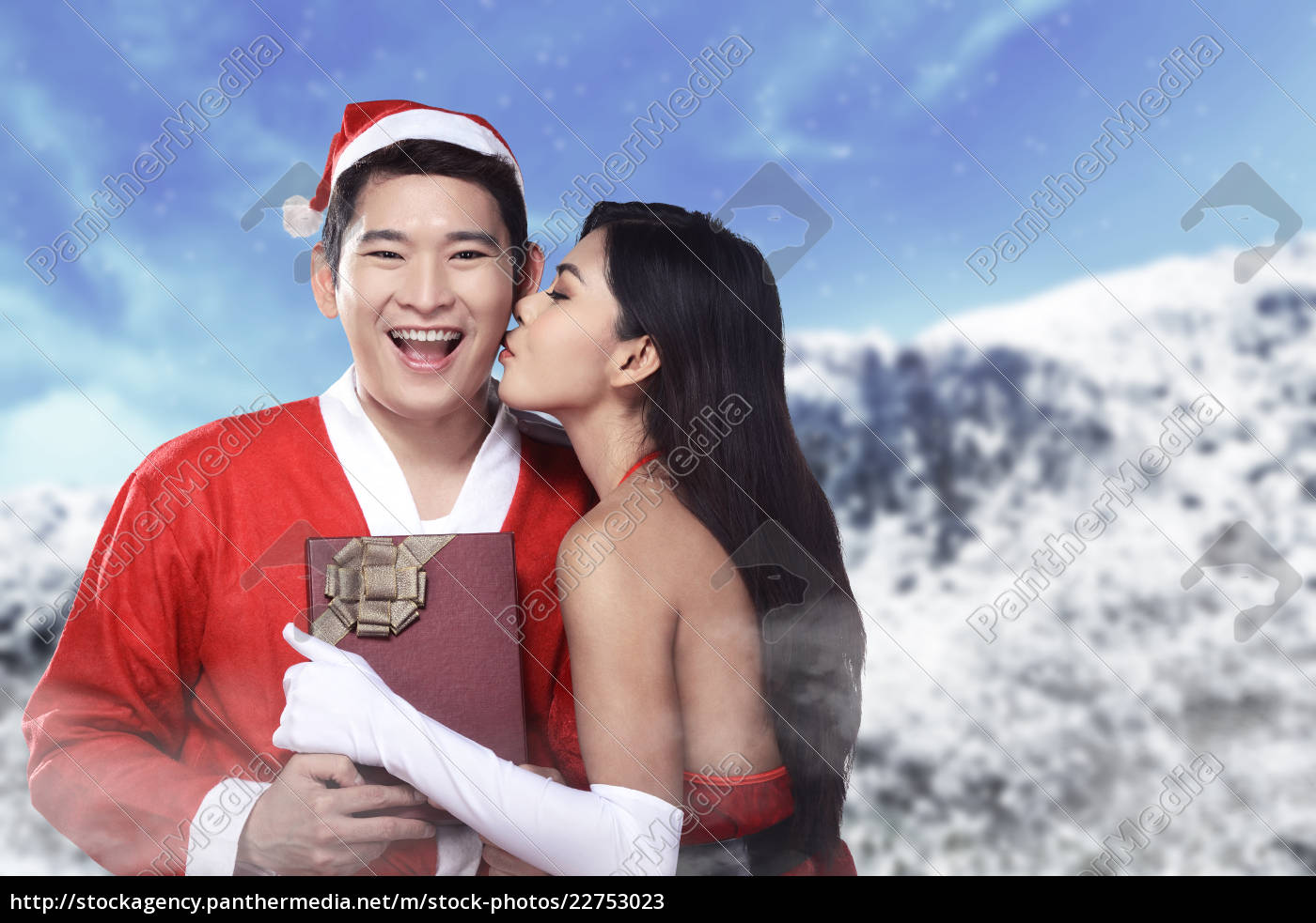 santa, woman, give, kiss, to, her - 22753023