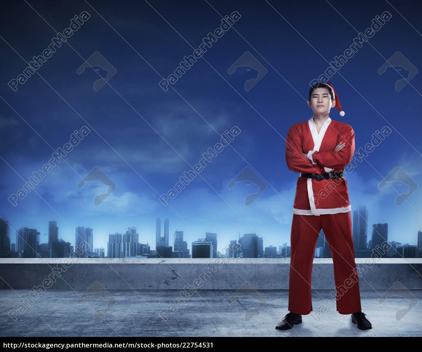 asian, man, in, santa, claus, costume - 22754531
