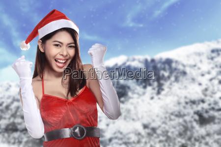 pretty, asian, woman, in, santa, claus - 22754559