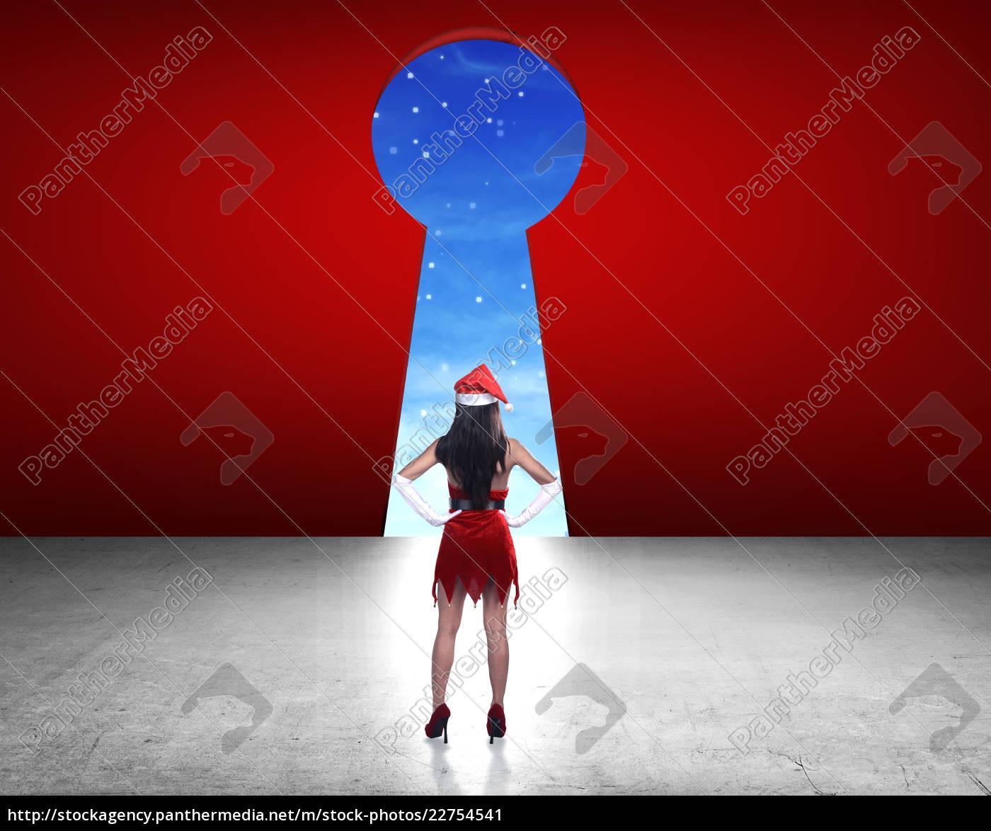 woman, wearing, santa, claus, costume, looking - 22754541