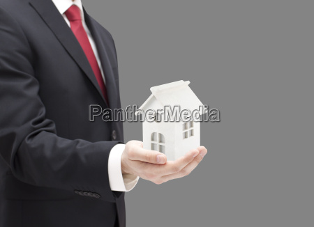 businessman, with, white, toy, house, miniature - 22755871