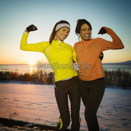 runners posing and flexing muscles in