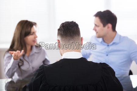 couple quarreling in front of judge