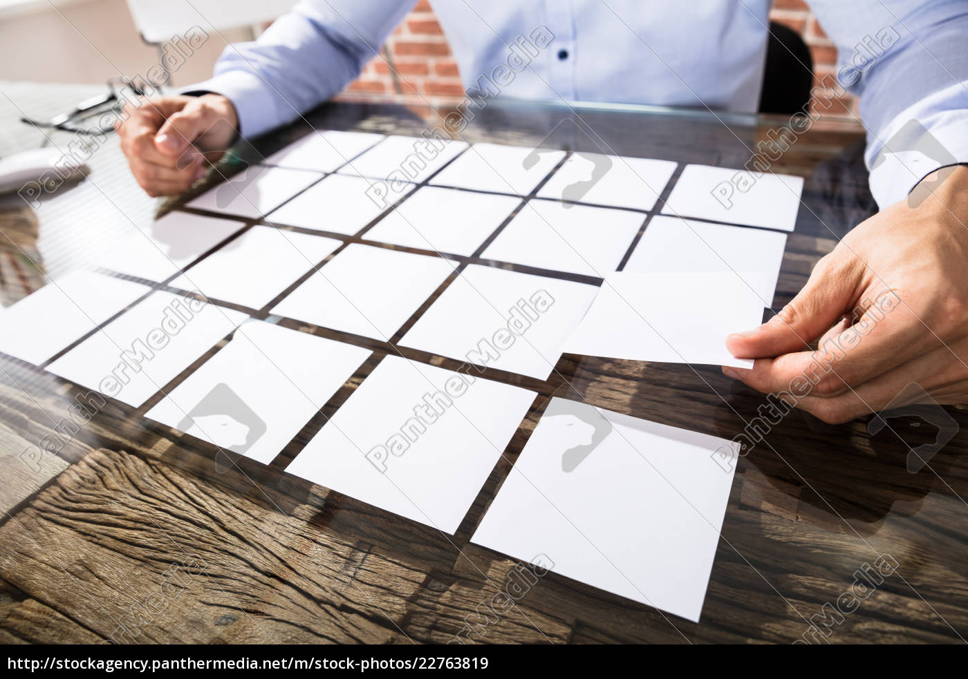 businessman, arranging, adhesive, notes, on, desk - 22763819