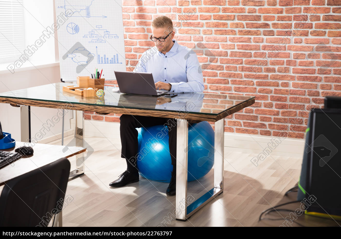 businessman, sitting, on, fitness, ball, working - 22763797