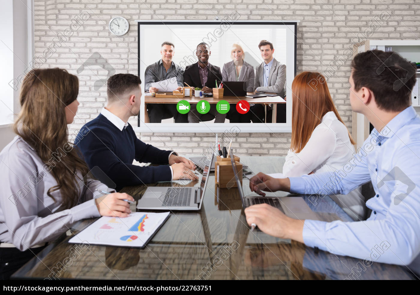 colleague, doing, video, conferencing, in, office - 22763751