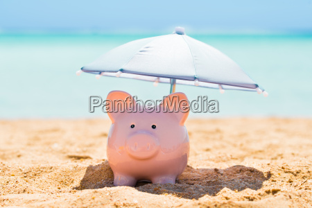 piggy bank under the parasol at