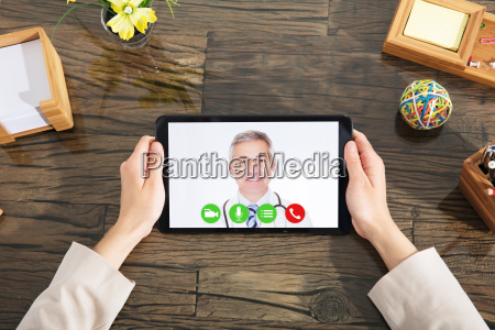 businesswoman doing video conference with a