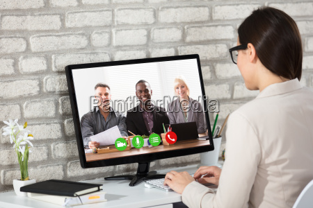 businesswoman doing video conference on computer