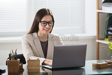 portrait of a businesswoman using laptop