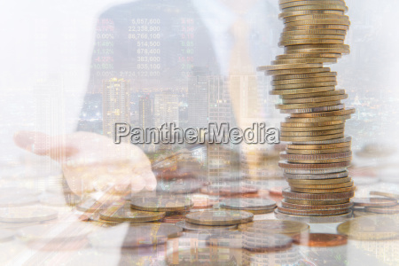 double exposure of city and coins