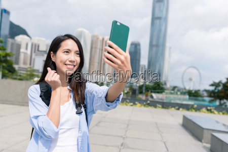 asian young woman taking selfie by