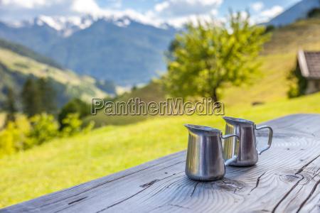 small milk jugs with mountain views