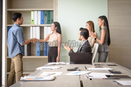 business people clapping in office after