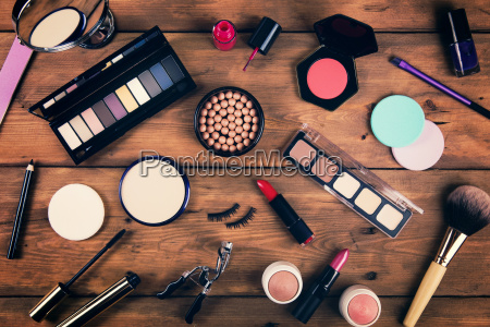 makeup cosmetics on wooden background top
