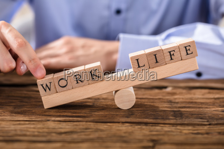 person showing misbalance between work and