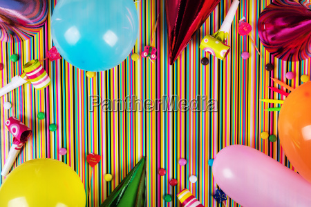 birthday party items on striped background