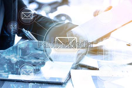 double exposure businessman writes business plan