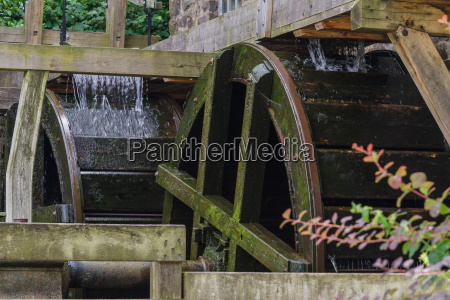 restored mill wheel of an old
