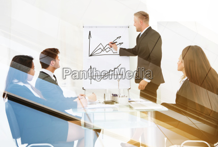 businessman giving presentation to colleagues