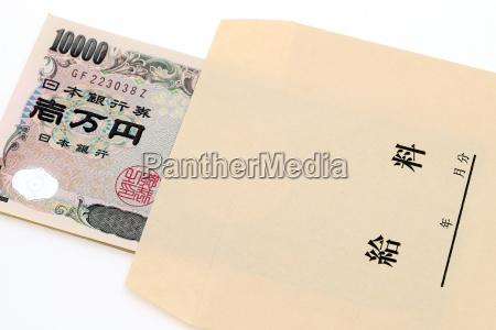 japanese money in salary envelope on