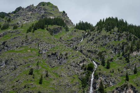 mountain and waterfall in the allgaeu