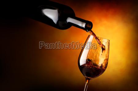 wineglass on orange background