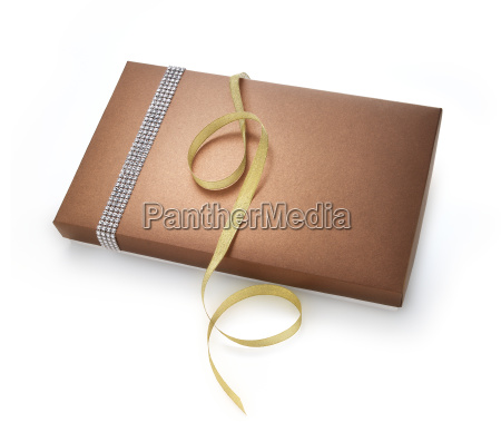 christmas gift box with golden tape