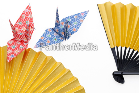 golden folding fan and origami bird