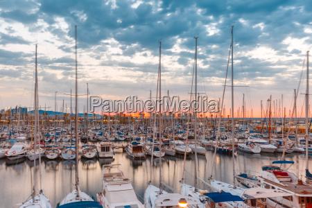 marina port vell at sunrise barcelona