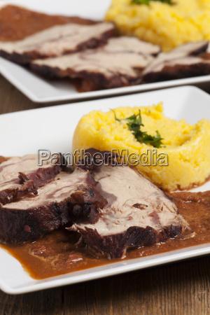 portion of veal with polenta