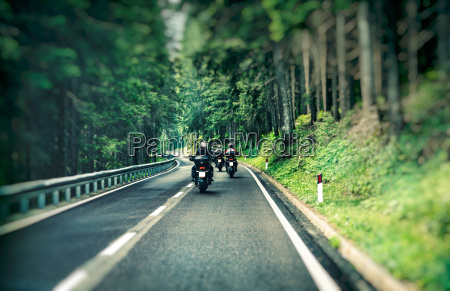 group of bikers on the highway