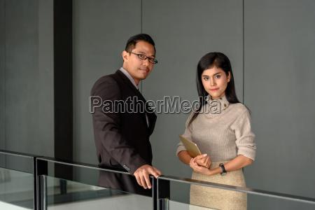 young asian businessman and beautiful secretary