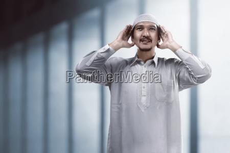 muslim man doing adzan