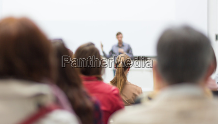 man giving presentation in lecture hall