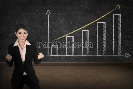 business person smile over increasing graph
