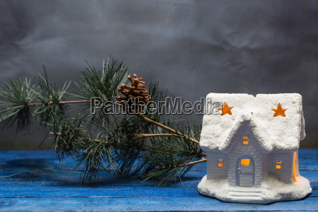 christmas house with candle and fir