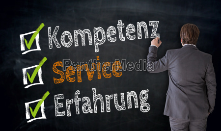 businessman writes competence service experience on
