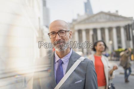 portrait confident businessman on urban city