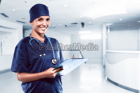 pretty asian doctor smiling with hospital
