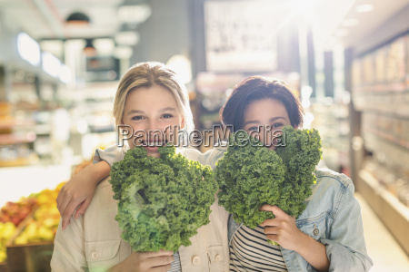 portrait playful young lesbian couple holding